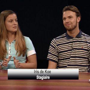 Printscreen van een mannelijke en vrouwelijke student aan tafel op nationale tv